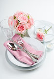 Luxurious table setting with pink roses Royalty Free Stock Photography