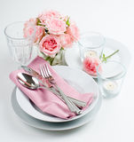 Luxurious table setting with pink roses Royalty Free Stock Photo