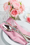 Luxurious table setting with pink roses Royalty Free Stock Photos
