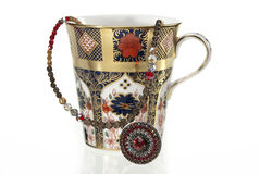 Luxurious tea cup with jewellery Royalty Free Stock Photography