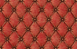 Luxurious texture of red leather upholstery. Royalty Free Stock Photography