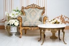 Luxurious vintage interior in the aristocratic style with elegant armchair and flowers. Retro, classics. Luxurious vintage interior in the aristocratic style stock photos