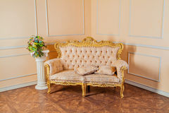 Luxurious vintage interior with armchair in the aristocratic sty Stock Photography