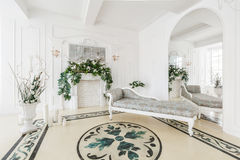 Luxurious vintage interior with fireplace in the aristocratic style.  Stock Photography