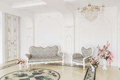 Luxurious vintage interior with fireplace in the aristocratic style.  Royalty Free Stock Photography