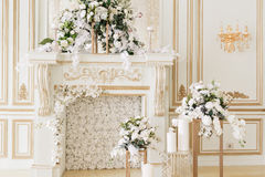 Luxurious vintage interior with fireplace in the aristocratic style.  Royalty Free Stock Photo