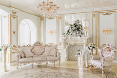 Luxurious vintage interior with fireplace in the aristocratic style.  Royalty Free Stock Images