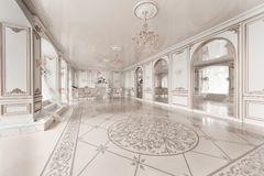 Luxurious vintage interior with fireplace in the aristocratic style. Large Windows and mirrors. Columns and arches. Ornament on the glossy floor Royalty Free Stock Photography