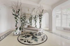 Luxurious vintage interior with mirror in the aristocratic style. Luxurious vintage interior with fireplace in the aristocratic style Stock Images