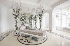 Luxurious vintage interior with mirror in the aristocratic style. Luxurious vintage interior with fireplace in the aristocratic style Royalty Free Stock Images