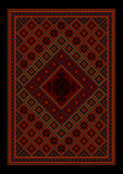 Luxurious vintage oriental carpet with colored ornament inmaroonand red shades Royalty Free Stock Photo