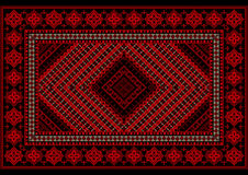 Luxurious vintage  rug in red shades with original pattern Royalty Free Stock Photos