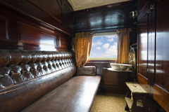 Luxurious vintage train carriage. Travelling inside a luxurious vintage train carriage Royalty Free Stock Photography