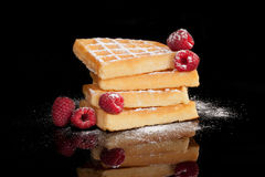 Luxurious waffle on black. Stock Photos