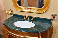 Luxurious washbasin and mirror in bathroom Stock Photography