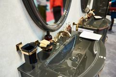 Luxurious washbasin and mirror in bathroom. Luxurious washbasin and mirror in the bathroom Stock Photography