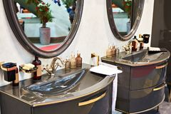 Luxurious washbasin and mirror in bathroom. Luxurious washbasin and mirror in the bathroom Stock Image