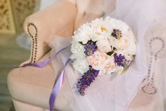 Luxurious wedding bouquet of purple, pink and white flowers. Wedding composition from multi-colored pions in a soft Royalty Free Stock Images