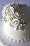 Luxurious wedding cake. Decorated with ice white flowers Stock Images