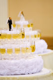 Luxurious wedding cake with wine glasses Stock Photo