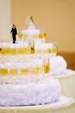 Luxurious wedding cake with wine glasses Stock Photo