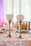 Luxurious wedding table. Matching crystal wine goblets on laid table at wedding reception Royalty Free Stock Images
