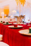 Luxurious wedding table with red tablecloth Royalty Free Stock Images