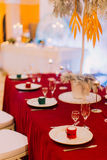 Luxurious wedding table with red tablecloth.  Wedding celebration Stock Photos