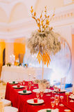 Luxurious wedding table with red tablecloth.  Wedding celebration Royalty Free Stock Photography
