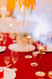 Luxurious wedding table with red tablecloth.  Wedding celebration Royalty Free Stock Images