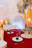 Luxurious wedding table with red tablecloth.  Wedding celebration Royalty Free Stock Photo