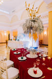 Luxurious wedding table with red tablecloth.  Wedding celebration Stock Photo