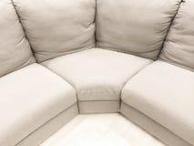 Luxurious white corner sofa Stock Photos