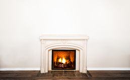 Luxurious White Marble Fireplace and empty wall Stock Photography