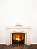 Luxurious White Marble Fireplace and empty wall Royalty Free Stock Photos