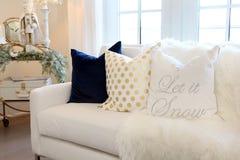 White sofa with Christmas cushion. Luxurious white sofa with Christmas cushion and ornaments royalty free stock image