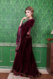 Luxurious woman dressed in vintage clothes in retro interior. Rococo period. Luxury and high class royalty free stock image