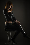 Luxurious woman sitting on a bar stool Stock Photos