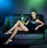 Luxurious women on sofa Stock Images