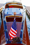 Classic wooden boat with American flag Royalty Free Stock Image