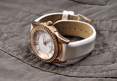 Luxurious wrist watch. Over denim cloth Royalty Free Stock Images