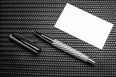 Luxurious writing tools. Luxurious rollerball pen on a carbon surface Royalty Free Stock Photography