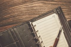 Luxurious writing tools. Luxurious rollerball pen and empty to do list Royalty Free Stock Photos