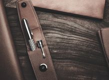 Luxurious writing tools. Luxurious rollerball pen on a wooden background Stock Image