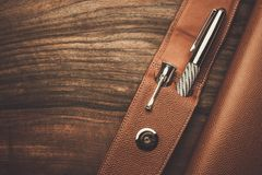 Luxurious writing tools. Luxurious rollerball pen on a wooden background Stock Photos