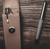 Luxurious writing tools. Luxurious rollerball pen on a wooden background Stock Photo