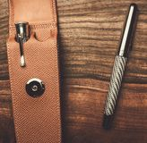 Luxurious writing tools. Luxurious rollerball pen on a wooden background Royalty Free Stock Image