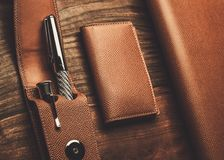 Luxurious writing tools. Luxurious rollerball pen on a wooden background Royalty Free Stock Images