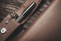 Luxurious writing tools. Luxurious rollerball pen on a wooden background Stock Images