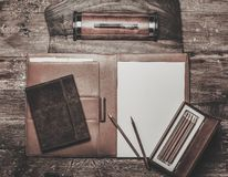Luxurious writing tools. On a wooden table Royalty Free Stock Photography